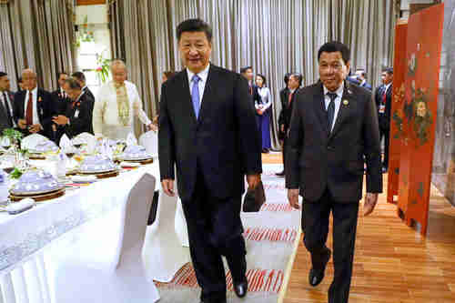 Xi Jinping and rodrigo Duterte meet in Hainan, China, in April 2018 (EPA)