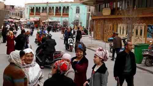 Uighur people mingle in the old town of Kashgar, Xinjiang, China on March 22, 2017 (Reuters)