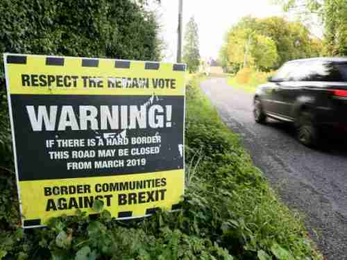 Brexit warning sign on road running across the Ireland-Northern Ireland border (AFP)