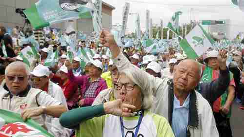 Pro-independence demonstrators shout slogans during a rally in Taipei, Taiwan, on Saturday (AP)