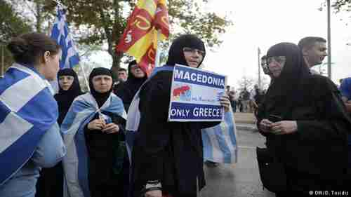 Greek Orthodox nuns holding Greek and Byzantine flags protest the Macedonia name deal. (Deutsche Welle)