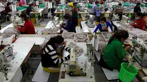 Employees at Cambodian clothes factory whose business is benefiting from EU trade preferences (Reuters)