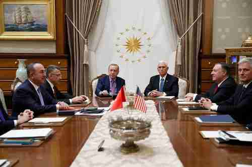 Thursday's negotiations in Ankara.  The Turks are on the left, and the Americans are on the right, led respectively by Tayyip Recep Erdogan and Mike Pence. (AP)