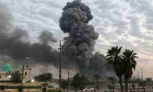 Plumes of smoke rise after an explosion at a military base in Iraq on August 12 (AP)