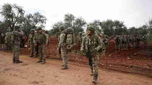 Turkish soldiers gather in Idlib, Syria (AFP)
