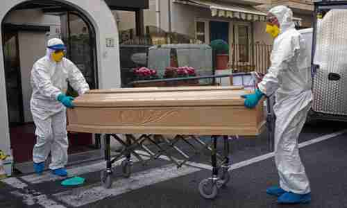 Medical staff with the coffin containing the body of Assunta Pastore, 87, who died at the Garden hotel in Laigueglia, north-west Italy, on Sunday. (AP)
