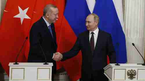 Recep Tayyip Erdogan and Vladimir Putin in Moscow on Thursday.  Erdogan is the lamb being led to slaughter.