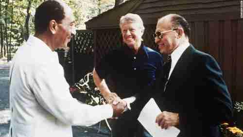 Egypt-Israel peace agreement handshake, on September 6, 1978, at Camp David.  Left to right: Egypt's president Anwar Sadat, US president Jimmy Carter, Israel's prime minister Menachem Begin (CNN)