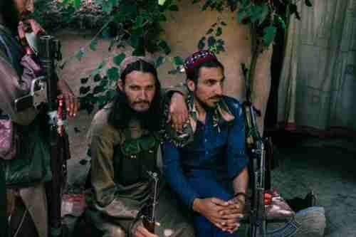 Taliban fighters relax after lunch (Washington Post)