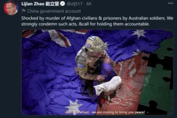 CCP tweet with fake picture of Australian soldier holding a knife to the neck of an Afghan baby, saying, 'Don't be afraid, we are coming to bring you peace'.  The baby and the knife are blurred in the above picture.  (SMH)