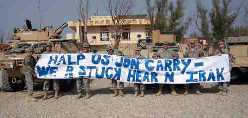 "Members of the Minnesota National Guard's 34th Infantry Division with a sign mocking John Kerry.  It says, ""HALP US JON CARRY - WE R STUCK HEAR N IRAK"" <font size=-2>(Source: Drudge Report)</font>"
