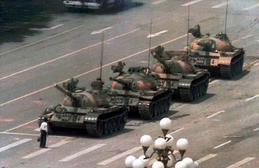 College student blocks path of a row of tanks in Tiananmen Square in China, 1989