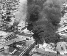 Left: Businesses burning in Watts riot in August, 1965; Right: Car burning in Fallujah riot in April, 2004