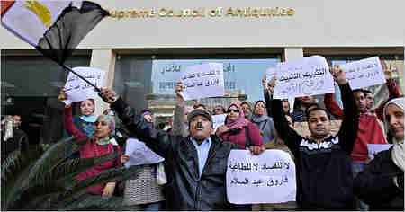 Striking museum workers in Cairo on Wednesday (AP)