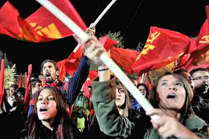 Hot communist chicks shout slogans in front of the Greek parliament building in Athens. (AFP)