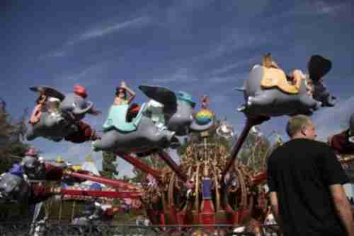 Visitors ride Dumbo the Flying Elephant at Disneyland in Anaheim on Thursday (AP)