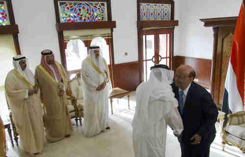 Hadi (in suit) meets Saudi ambassador and entourage (Reuters)