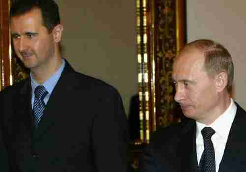 Bashar al-Assad and Vladimir Putin, probably planning their next massacre (Reuters)