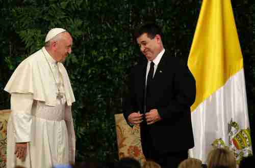 Pope Francis and Paraguay's President Horacio Cartes meet inside the López Presidential Palace, in Asunción, Paraguay on Friday.  The palace was named after president Carlos Antonio López, the father of president Francisco Solano López, who launched the War of the Triple Alliance (AP)