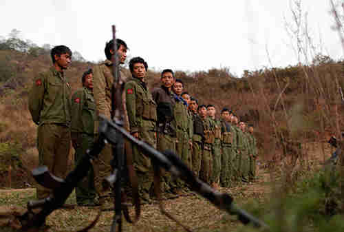 Rebel soldiers of Myanmar National Democratic Alliance Army (MNDAA) gather at a military base in Kokang region in March (Reuters)