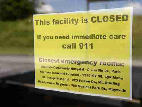 Sign announcing the closure of Kentucky's Nicholas County Hospital because of Obamacare-related bankruptcy (USA Today)