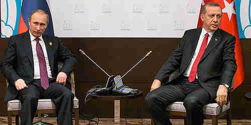 Vladimir Putin and Recep Tayyip Erdogan at their last 'friendly' meeting, on November 16, a week before Russia's warplane was shot down over Turkey (AP)