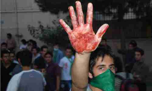 A protester held up a bloody hands in the protests in Tehran following the 2009 elections (Getty)