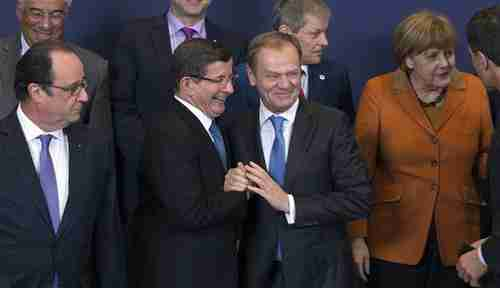 Gleeful European and Turkish leaders at Brussels meeting (Reuters)