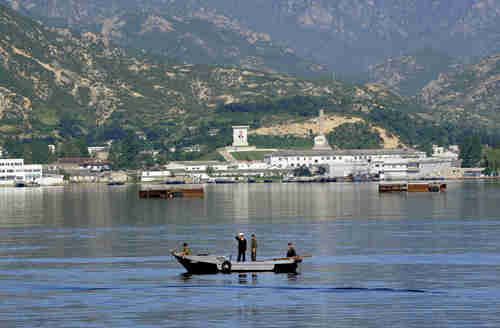 Cruise ship prepares to dock at the port in the Kumgang Mountain Resort in North Korea (AFP)