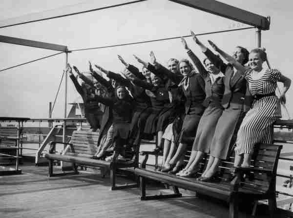 1938: English girls giving Nazi salute returning from a field trip to Germany - 'We had the time of our lives!' (Der Spiegel)