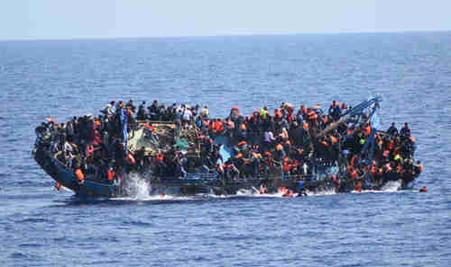 Boat carrying hundreds of migrants capsized on Thursday as an Italian Navy rescue ship approached (Getty)