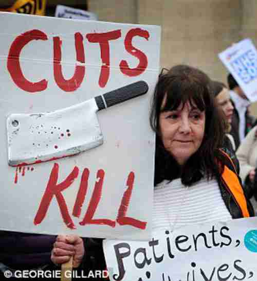 Protester against cuts to UK's National Health Service (Daily Mail)