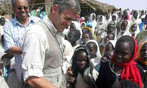 Celebrity star George Clooney visiting a Darfur refugee camp in 2008 (AP)