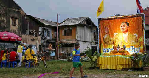 Thailand neighborhood with shrine to King Bhumibol (Reuters)
