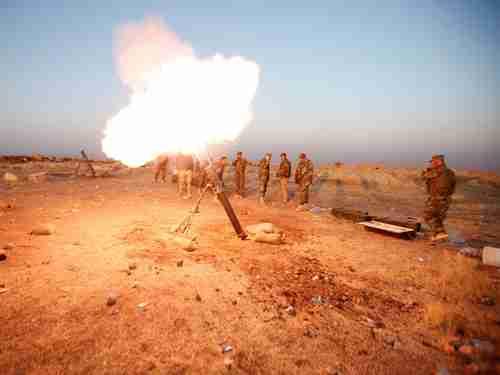 Kurdish Peshmerga forces fire a mortar towards ISIS positions near Mosul last week (Reuters)